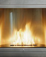 Stainless steel square ventless fireplace with curved interior medium cropped