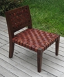 Woven leather chair.jpg medium cropped